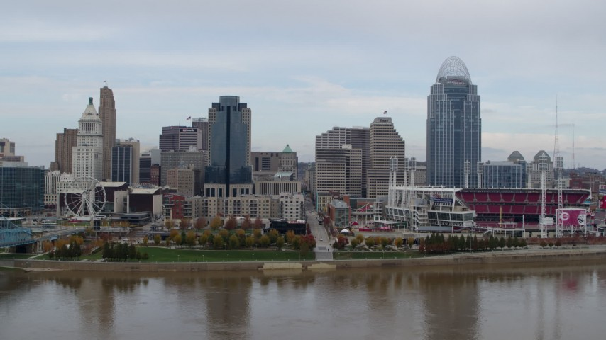 5.7K stock footage aerial video passing by city skyline and baseball stadium, seen from the river, Downtown Cincinnati, Ohio Aerial Stock Footage DX0001_002590