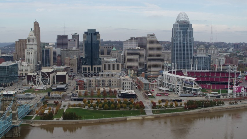 5.7K aerial video ascend and fly away from city skyline and baseball stadium by Ohio River, Downtown Cincinnati, Ohio Aerial Stock Footage DX0001_002596