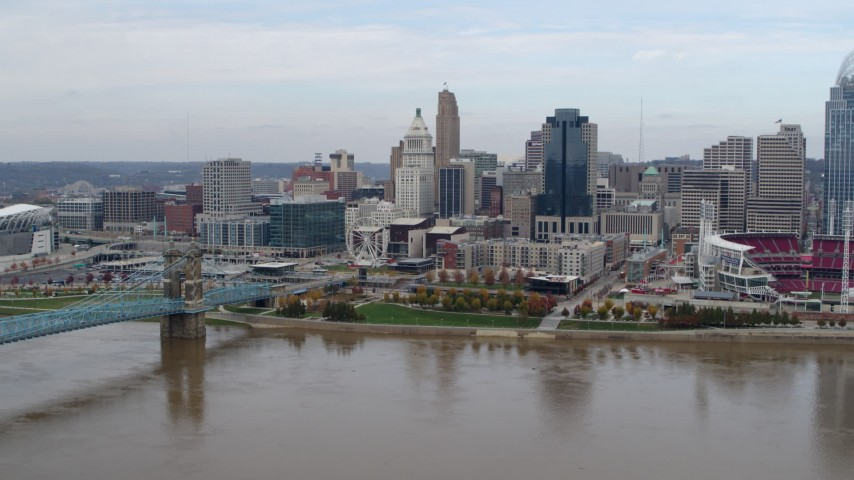 5.7K stock footage aerial video of a view of the city skyline and bridge by Ohio River during descent, Downtown Cincinnati, Ohio Aerial Stock Footage | DX0001_002599