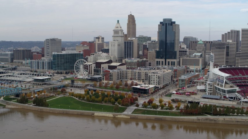 5.7K aerial video reverse view of the city's skyline seen from the river, Downtown Cincinnati, Ohio Aerial Stock Footage | DX0001_002607
