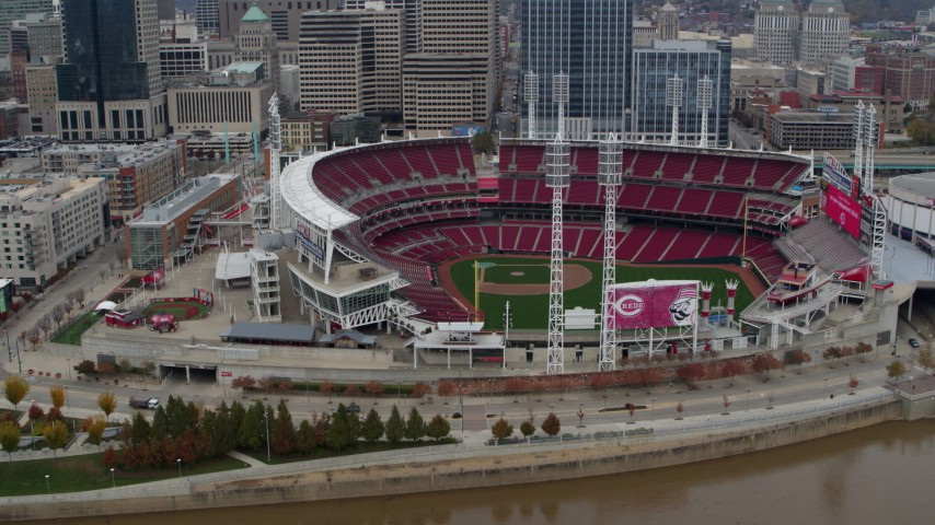 5.7K stock footage aerial video ascend from Ohio River to approach the baseball stadium, Downtown Cincinnati, Ohio Aerial Stock Footage | DX0001_002609
