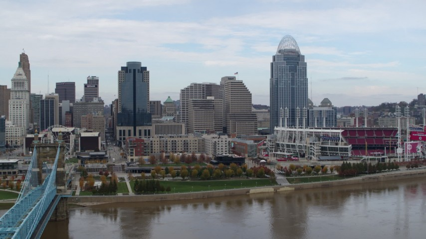 5.7K aerial video passing by riverfront baseball stadium and skyline, seen from river, Downtown Cincinnati, Ohio Aerial Stock Footage | DX0001_002615