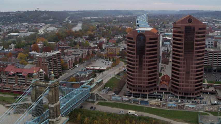 5.7K stock footage aerial video of two riverfront office buildings during descent by bridge in Covington, Kentucky Aerial Stock Footage   DX0001_002623
