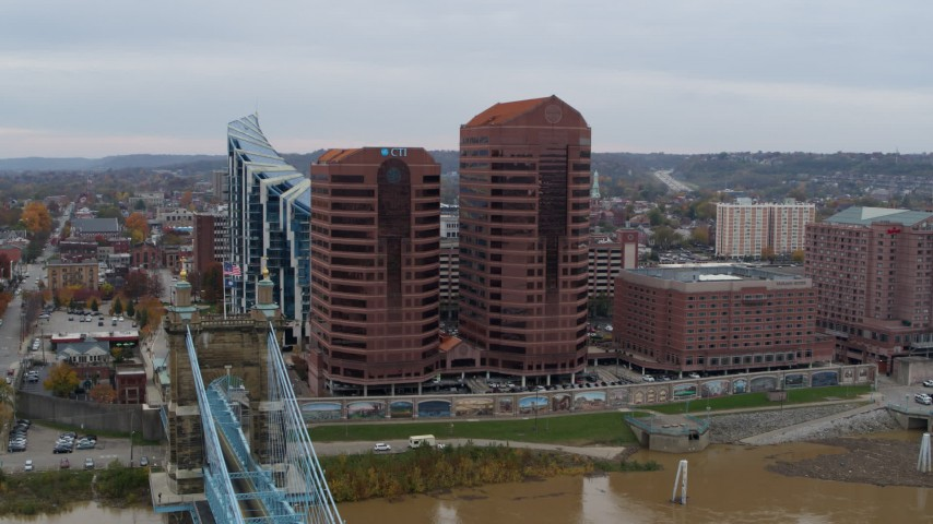 5.7K stock footage aerial video reverse view of two riverfront office buildings and bridge in Covington, Kentucky Aerial Stock Footage | DX0001_002624