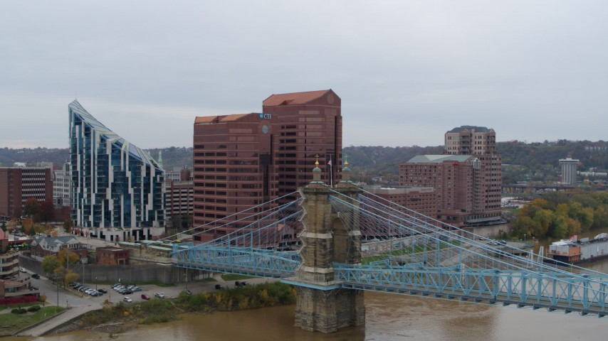 5.7K stock footage aerial video of flying by two riverfront office buildings and bridge in Covington, Kentucky Aerial Stock Footage   DX0001_002625