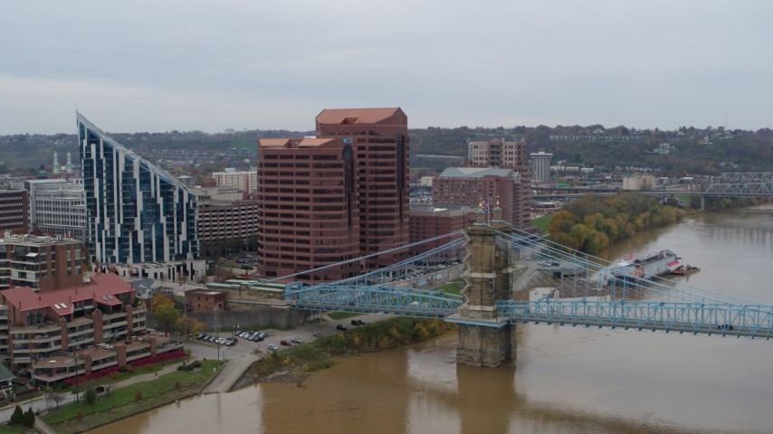5.7K stock footage aerial video of a condominium complex, two riverfront office buildings and bridge in Covington, Kentucky Aerial Stock Footage | DX0001_002626