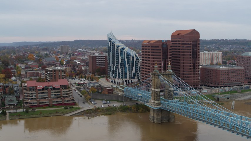 5.7K stock footage aerial video of passing a condominium complex, two riverfront office buildings and bridge in Covington, Kentucky Aerial Stock Footage   DX0001_002627