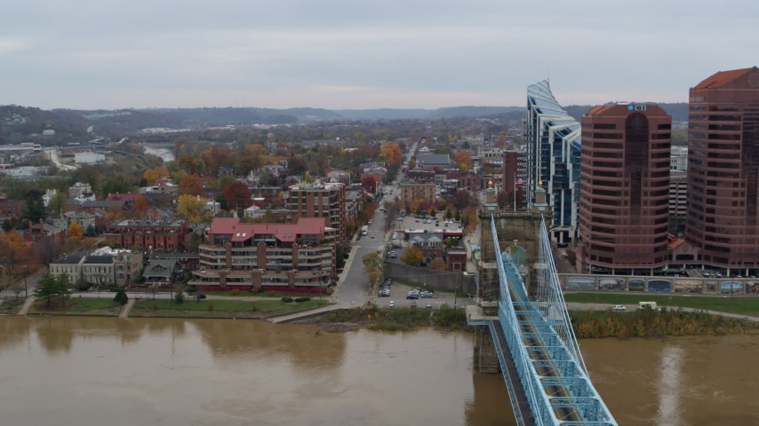 5.7K stock footage aerial video of flying by a bridge for view of two riverfront office buildings in Covington, Kentucky Aerial Stock Footage | DX0001_002628