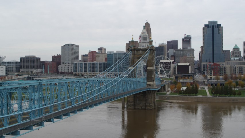 5.7K aerial video fly over Ohio River beside the bridge toward the city skyline, Downtown Cincinnati, Ohio Aerial Stock Footage | DX0001_002634