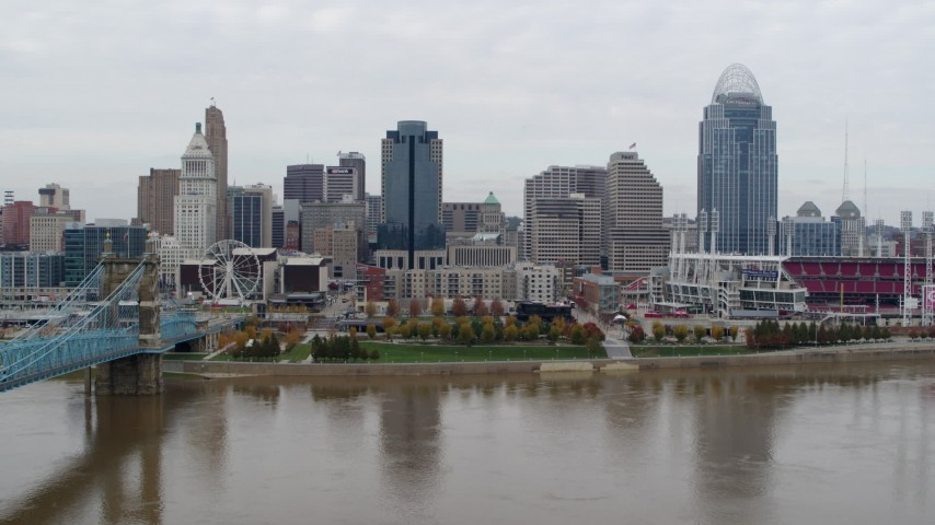 5.7K aerial video of the city's downtown skyline across the Ohio River, Downtown Cincinnati, Ohio Aerial Stock Footage | DX0001_002645