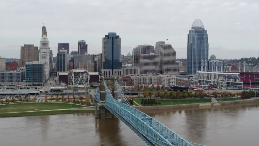 5.7K stock footage aerial video flyby the city's downtown skyline, seen from bridge spanning Ohio River, Downtown Cincinnati, Ohio Aerial Stock Footage | DX0001_002649