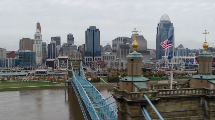 5.7K stock footage aerial video flyby the city's downtown skyline, seen from a bridge spanning Ohio River, Downtown Cincinnati, Ohio Aerial Stock Footage | DX0001_002650