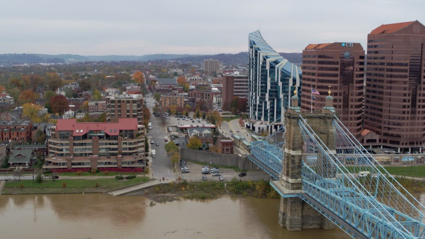 5.7K stock footage aerial video flyby Roebling Bridge near condo complex and office buildings in Covington, Kentucky Aerial Stock Footage | DX0001_002653