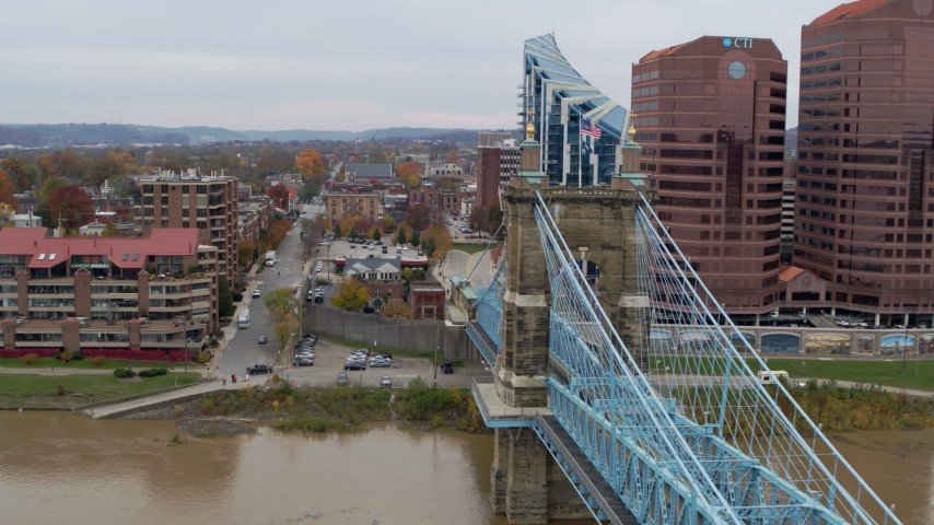 5.7K stock footage aerial video descend by Roebling Bridge toward the Ohio River in Covington, Kentucky Aerial Stock Footage | DX0001_002654