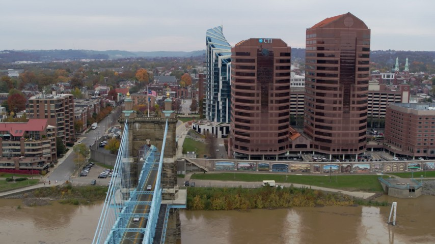 5.7K stock footage aerial video flyby bridge and office buildings, reveal riverfront condo complex in Covington, Kentucky Aerial Stock Footage   DX0001_002657