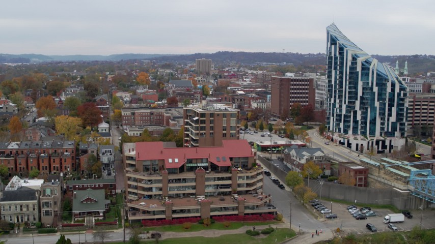 5.7K stock footage aerial video ascend by riverfront condo complex for view of brick buildings in Covington, Kentucky Aerial Stock Footage | DX0001_002658