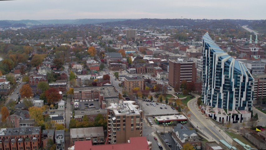 5.7K stock footage aerial video reverse view of brick buildings near condo complex in Covington, Kentucky Aerial Stock Footage   DX0001_002659