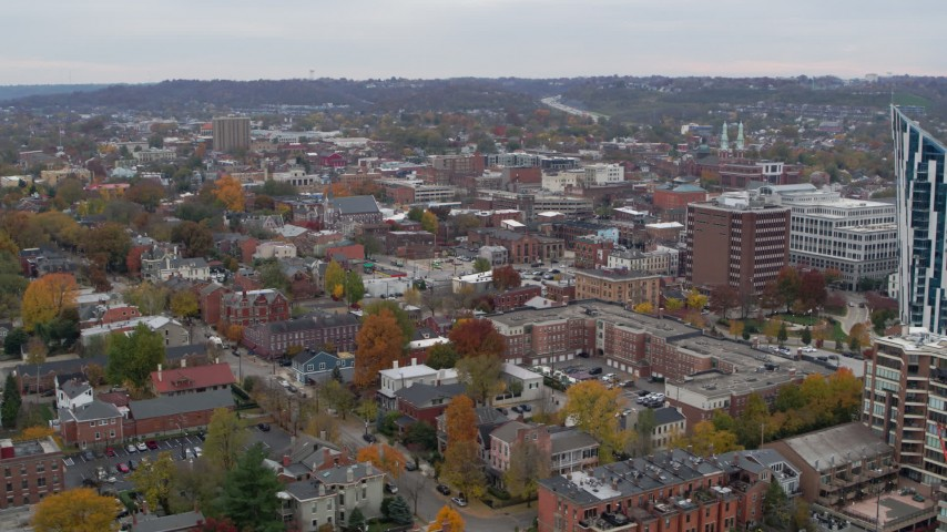5.7K stock footage aerial video of flying by brick buildings in downtown to reveal modern condo complex, Covington, Kentucky Aerial Stock Footage | DX0001_002667