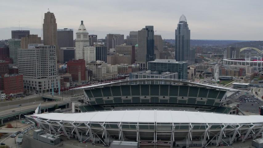 5.7K aerial video flyby football stadium and focus on city skyline in Downtown Cincinnati, Ohio Aerial Stock Footage | DX0001_002674