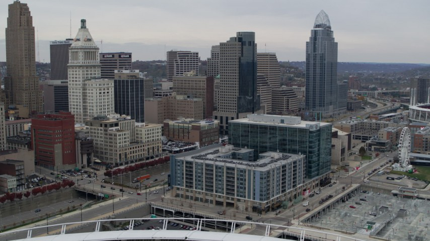 5.7K stock footage aerial video flyby apartment and office buildings near tall skyscrapers in Downtown Cincinnati, Ohio Aerial Stock Footage | DX0001_002675
