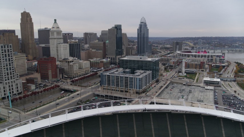 5.7K stock footage aerial video of apartment and office buildings near skyscrapers seen from the football stadium in Downtown Cincinnati, Ohio Aerial Stock Footage | DX0001_002680