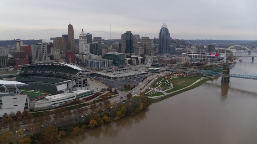 5.7K aerial video flyby football stadium and skyline, seen from Ohio River in Downtown Cincinnati, Ohio Aerial Stock Footage | DX0001_002683