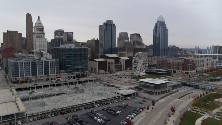 5.7K aerial video reverse view of apartment and office buildings near skyscrapers in Downtown Cincinnati, Ohio Aerial Stock Footage | DX0001_002689
