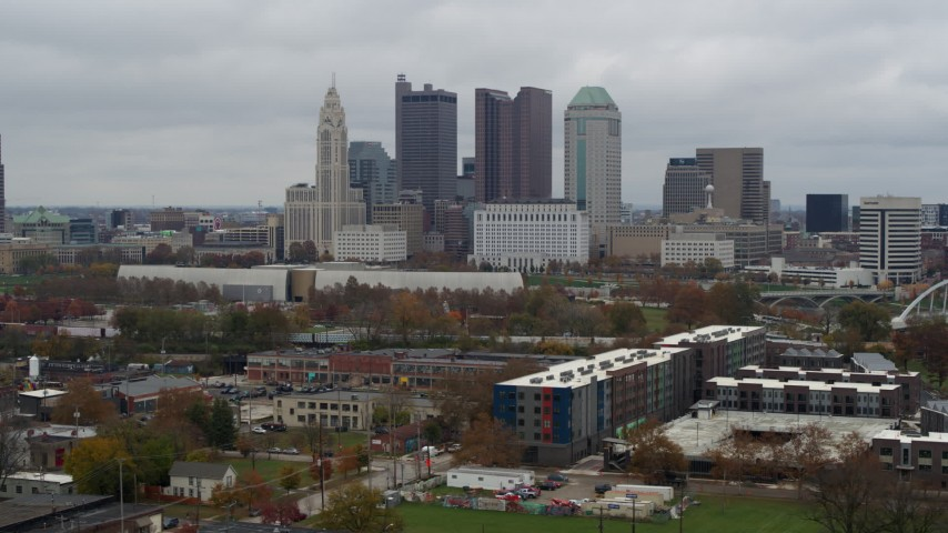 5.7K aerial video of flying by the city's skyline in Downtown Columbus, Ohio Aerial Stock Footage | DX0001_002693
