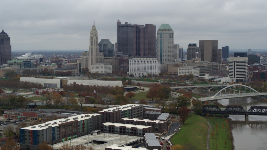5.7K stock footage aerial video descend with view of the city's skyline and the Scioto River in Downtown Columbus, Ohio Aerial Stock Footage | DX0001_002699