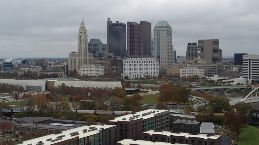 5.7K stock footage aerial video slowly fly away from the city's skyline and the Scioto River in Downtown Columbus, Ohio Aerial Stock Footage | DX0001_002701