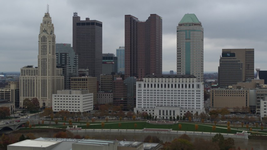 5.7K stock footage aerial video flying by four tall skyscrapers in the city's skyline in Downtown Columbus, Ohio Aerial Stock Footage | DX0001_002704