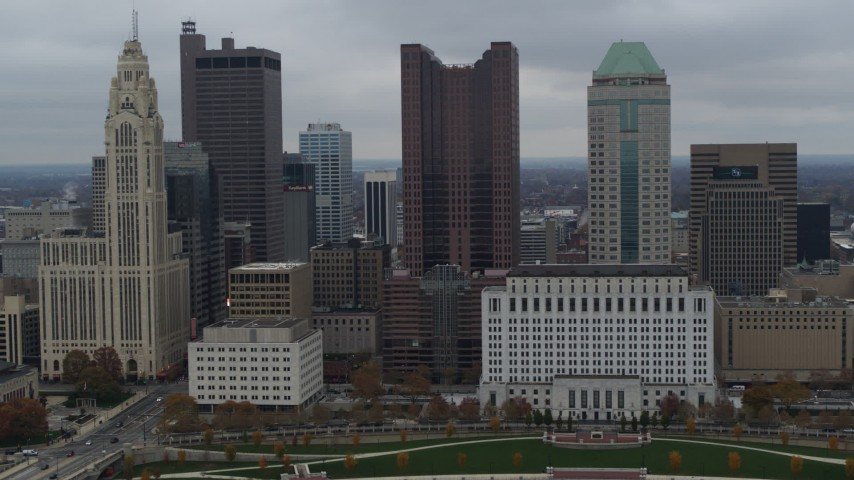 5.7K stock footage aerial video slowly passing by four tall skyscrapers in the city's skyline in Downtown Columbus, Ohio Aerial Stock Footage | DX0001_002706