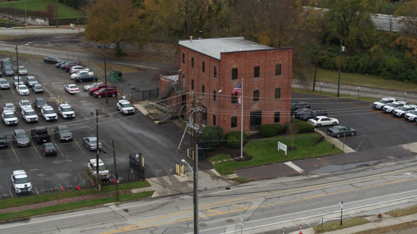 5.7K aerial video of orbiting a small brick police station in Columbus, Ohio Aerial Stock Footage | DX0001_002709
