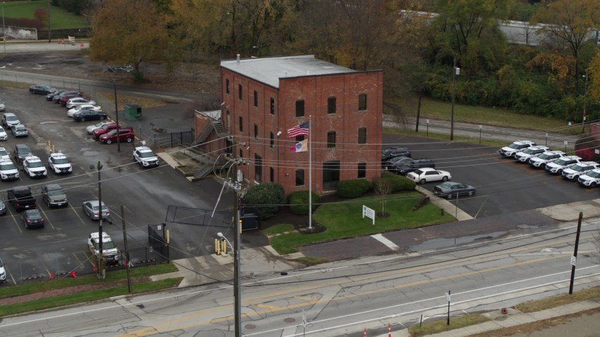5.7K aerial video orbit a small brick police station in Columbus, Ohio Aerial Stock Footage | DX0001_002710