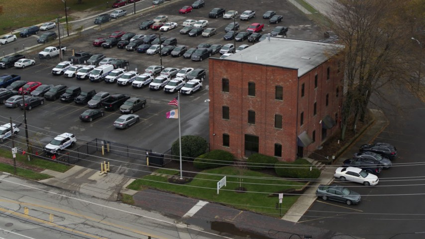 5.7K aerial video of approaching a small brick police station in Columbus, Ohio Aerial Stock Footage DX0001_002711
