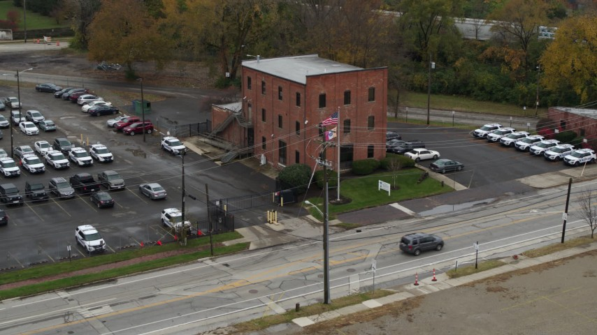 5.7K aerial video of an orbit around a small brick police station in Columbus, Ohio Aerial Stock Footage | DX0001_002712