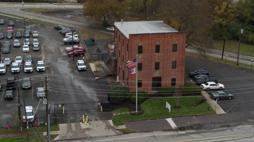 5.7K aerial video ascend while approaching a brick police station in Columbus, Ohio Aerial Stock Footage | DX0001_002715