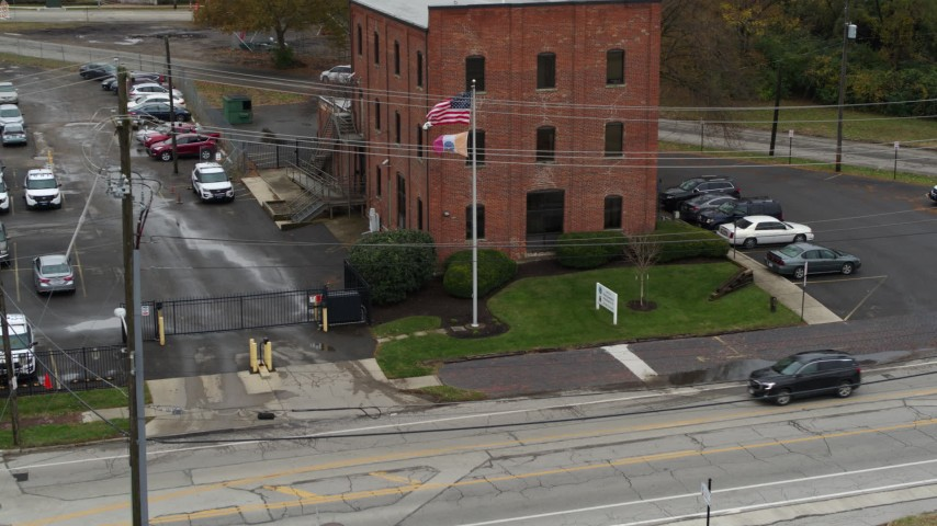 5.7K aerial video descend and fly away from a brick police station in Columbus, Ohio Aerial Stock Footage | DX0001_002716