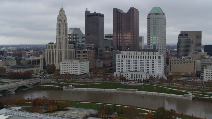 5.7K aerial video of approaching the Scioto River and the city skyline, Downtown Columbus, Ohio Aerial Stock Footage | DX0001_002722