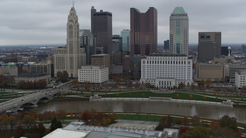 5.7K aerial video of a reverse view of the Scioto River and the city skyline, Downtown Columbus, Ohio Aerial Stock Footage DX0001_002723
