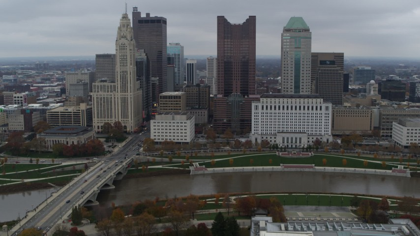 5.7K aerial video flyby the city's skyline and river near Discovery Bridge, Downtown Columbus, Ohio Aerial Stock Footage DX0001_002730