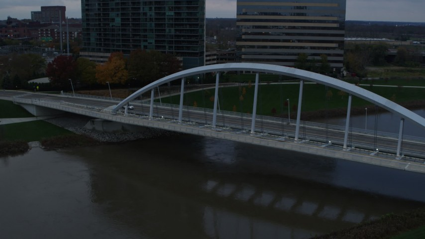 5.7K aerial video of the Main Street Bridge spanning the Scioto River at sunset, Downtown Columbus, Ohio Aerial Stock Footage | DX0001_002737