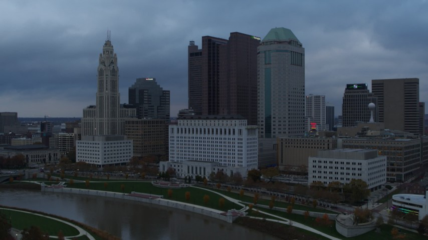 5.7K aerial video city skyline on the other side of the Scioto River at sunset, Downtown Columbus, Ohio Aerial Stock Footage | DX0001_002739