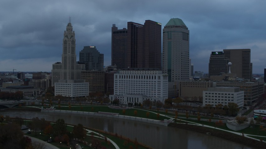 5.7K aerial video flyby the city skyline and the Scioto River at sunset during ascent, Downtown Columbus, Ohio Aerial Stock Footage | DX0001_002747