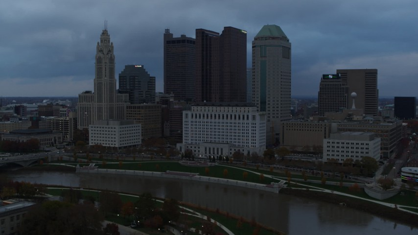 5.7K aerial video stationary view of the city skyline and the Scioto River at sunset, Downtown Columbus, Ohio Aerial Stock Footage | DX0001_002750
