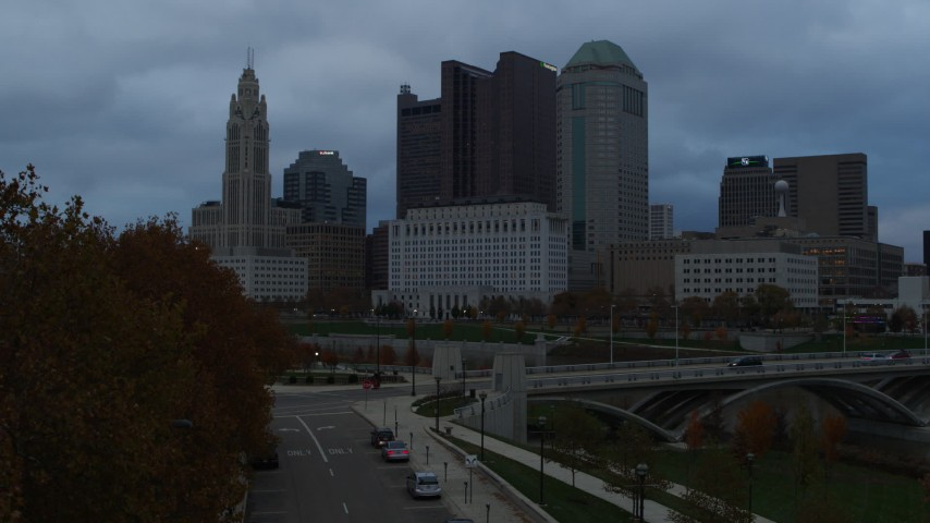 5.7K aerial video of the city skyline and the Scioto River at sunset during descent, Downtown Columbus, Ohio Aerial Stock Footage | DX0001_002752