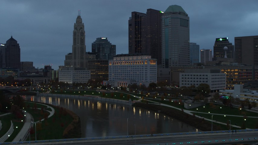 5.7K stock footage aerial video of the city skyline and the Scioto River at sunset during ascent, Downtown Columbus, Ohio Aerial Stock Footage | DX0001_002753