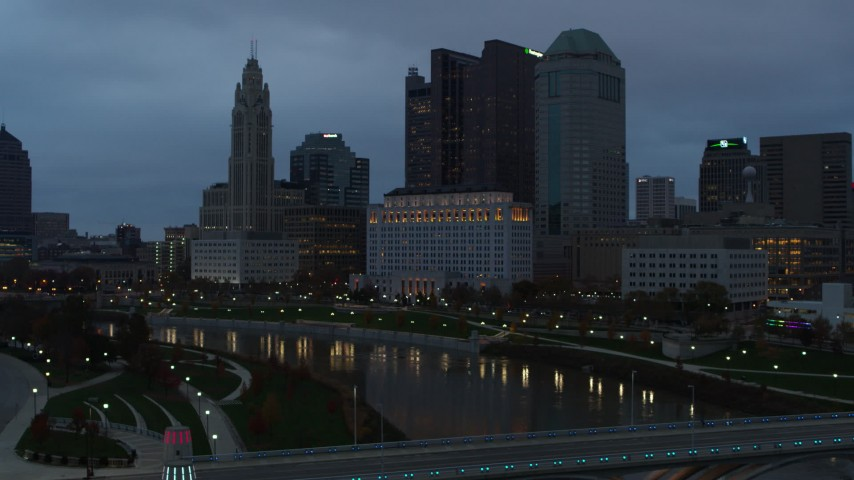 5.7K aerial video flyby Scioto River and city skyline at sunset, Downtown Columbus, Ohio Aerial Stock Footage | DX0001_002757