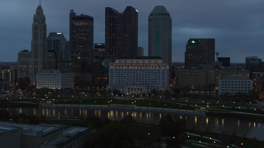 5.7K stock footage aerial video of the city skyline by the Scioto River at sunset, Downtown Columbus, Ohio Aerial Stock Footage | DX0001_002758