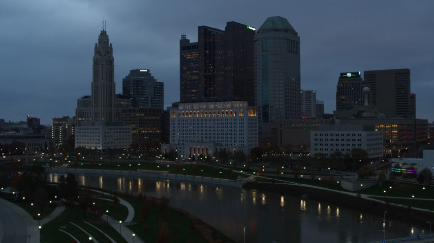5.7K stock footage aerial video of the city skyline by the Scioto River seen from museum at sunset, Downtown Columbus, Ohio Aerial Stock Footage | DX0001_002759